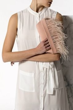 Bring a glamorous edge to your evening look with the Domna design clutch. This unique and ultra classy formal handbag is handmade of fine quality leather and silky feathers. It comes in 3 colors, nude (nubuck), black and camel (waxed tan). Greek Chic Handmades bags are designed and handcrafted in Athens, Greece. Shop your favorite leather bag to accompany your handmade sandals. Most importantly we use the same premium leather we built the sandals with and the impeccable local craftsmanship. Beach Wedding Sandals, Clutches For Women, Pink Clutch, Wedding Clutch, Brunch Outfit, Leather Clutch Bags, Leather Bags Handmade, Bohemian Style, Feathers