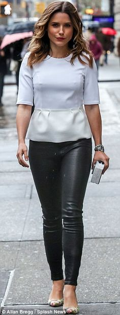 All in a New York City minute! Sophia Bush displayed her toned pins in tight leather pants on Tuesday, after frocking up in a classy blue la...
