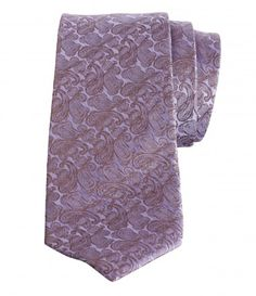 PAISLEY PATTERNED WOVEN TIE  When it comes to dapper patterns, paisley's hard to beat and this beautifully woven silk-tie from Stanza features the design in purple.