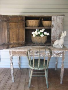 .love the rustic farmhouse table and chair and old cabinet behind with baskets.....