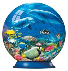 """This 270 piece 3D Puzzleball features perfectly crafted, curved puzzle pieces allowing for an exact fit and easy assembly. The pieces form a solid, smooth ball with no glue required. Comes with a base stand. Measures 6"""" in diameter. Released January 2013."""