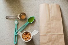 Popcorn in a paper bag is the only way we eat popcorn at home. This recipe calls for a microwave time of 2 minutes for 1/4 cup, but we only pop ours for 1 minute 35 seconds to avoid burnt kernels. Cook time definitely depends on your microwave so you may have to play around with pop time.