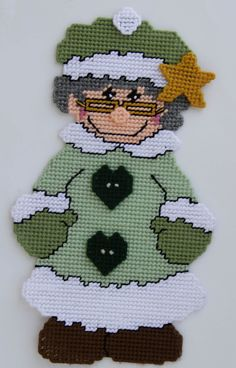Plastic canvas Mrs Claus wall hanging - although I'd make her clothing red rather then green. Plastic Canvas Ornaments, Plastic Canvas Crafts, Plastic Canvas Patterns, Cross Stitch Books, Cross Stitch Patterns, Plastic Canvas Christmas, Holiday Crochet, Christmas Characters, Canvas Designs