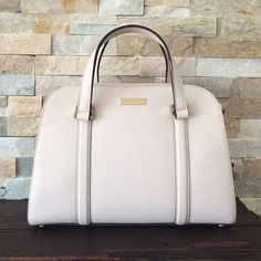 BRAND NEW (W/ TAGS) BONE WHITE KATE SPADE PURSE BRAND NEW WITH TAGS!!! 100% authentic. comes with a adjustable & removable shoulder strap! 3 inside pockets. 11 x 4 1/2 x 8 (Length x Width x Height) no trades, I'm looking to sell :) if you want to make an offer, please do through the offer button. let me know if you have any questions! xoxo kate spade Bags Totes