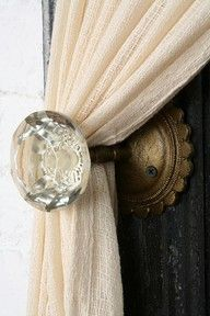 Antique glass door knob as curtain holdback