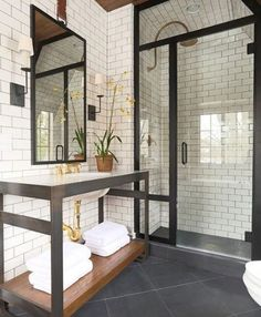 IRON METAL PAIRED WITH A DARK FLOOR AND SUBWAY TILE