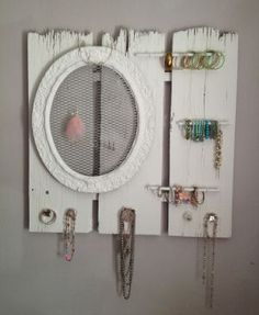 diy jewelry storage organizer (at first I thought the earring mesh frame was a mirror -- that could've been a useful addition, perhaps)