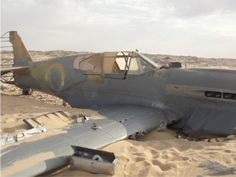 A crash-landed P-40 KittyHawk found abandoned in the Sahara desert, courtesy of the Retronaut site