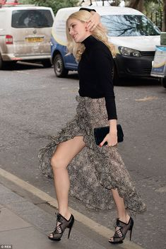 Leggy lady: Pixie Lott showed off her slim pins in a daring skirt at the Year of Mexico lunch at The Savoy hotel in London on Tuesday