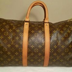 Louis Vuitton Keepall 45 In great condition. Has minor cracking in the folds and some minor unnoticeable cracking on the handles. Better price elsewhere. Louis Vuitton Bags Travel Bags