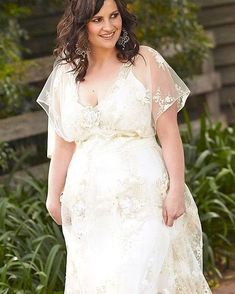 This boho chic wedding gown has pretty sheer short sleeves. The empire waist is flattering. Get custom #plussizeweddingdresses like this made to order with any design preferences. Our firm also specializes in making #replicas of couture #weddingdresses. So if your favorite design is more than you can afford we can make a version that will have the same look for less.