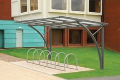 Very similar to the bike shelters at Brunel. This design does not require a counterweight due sturdy foundations.