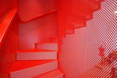 Hanging Red Stairs / Michaelis Boyd Associates