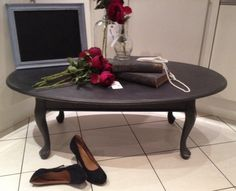Oval Coffee Table With Queen Anne Legs Finished In Granite For A Gravitas.