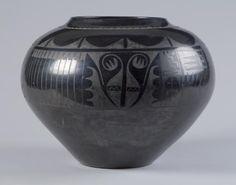Large black-on-black storage jar  Maria Martinez (1889 – 1980, San Ildefonso Pueblo)  Julian Martinez (1879 – 1943, San Ildefonso Pueblo)  Native clays  1940  1946.46.1    Gift of Clark Field