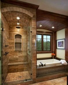 steam shower with tub, glass blocks in between for extra light, lower window to increase view when sitting in tub. Use wall studs instead of picture as storage for shampoo, incense, etc.
