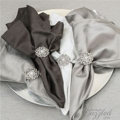 Check out this site for the prettiest rhinestone and pearl napkin rings.  These beauties are only $2 each at www.totallydazzled.com