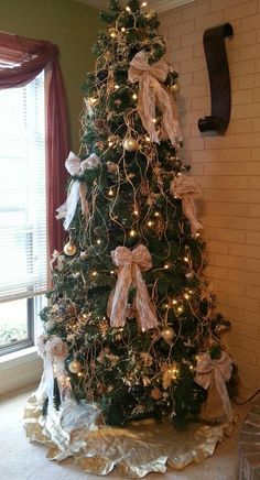 Country christmas tree with burlap bows and twine
