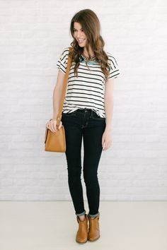 basic outfit {striped tee, dark wash denim, boots} turned up a notch with a statement necklace.