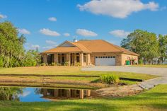Horse Properties for Sale in Osceola County in Florida.Elegant lakefront 3122 sqft pool home on Lake Gentry, with 4 br and 3 full baths boasts its own private plane hangar, 10+ acres, and includes a completely remodeled 1540 sqft guest house with 3 br and 1 bath. Main home has formal living room, and dining room with custom china cabinet wall units.