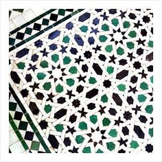 Moroccan mosaic tiles flecked with emerald green