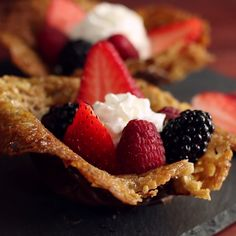 Crispy, chocolatey cookie bowls filled with fruit guarantees a berry good time.