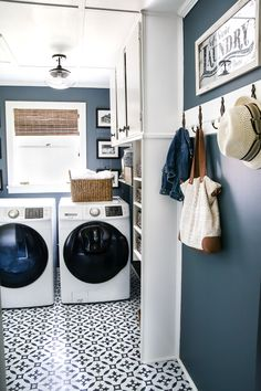 A dingy and dated laundry room gets a high contrast navy and white makeover packed with organizational strategies and budget-conscious DIY projects. Laundry Room Colors, White Laundry Rooms, Mudroom Laundry Room, Laundry Room Remodel, Laundry Room Cabinets, Farmhouse Laundry Room, Laundry Room Organization, Laundry Room Design, Colorful Laundry Rooms