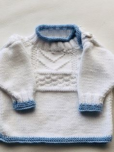 Baby Jumper, with added blue trim. 'Gurnsey Frock' by Kim Hargreaves from Rowan Book Eleven. Knitted in Rowan Hand Knit Cotton and added blue coloured trim and a shoulder button plackett.