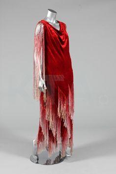 A scarlet velvet flapper dress, early 1920s, adorned with degradée fringes to the shoulders and skirt.. @designerwallace