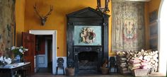 """The Front Hall to in Leixlip Castle exemplifies Mariga Guinness's style that """"combined fantasy with history and the grand with the laid-back, all in a natural and seemingly uncontrived …"""