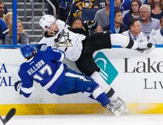 That's going to leave a check mark:    Alex Killorn of the Tampa Bay Lightning is checked by Brian Dumoulin of the Pittsburgh Penguins during the first period of Game 3 in the Eastern Conference finals at the Amalie Arena on May 18 in Tampa, Fla.