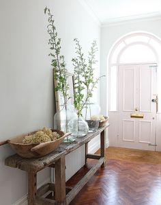 Clear vases, tall branches