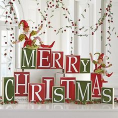 """Add a little magic to your mantel or any tabletop with """"Merry Christmas"""" Blocks."""