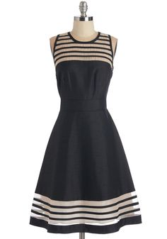 You're bound to be the talk of the party when seen mixing and mingling in this black cocktail dress! Sheer stripes at the neckline and hem lend striking contrast to the slightly shimmery silhouette of this exposed-zip frock, which instantly impresses after only a single glance.