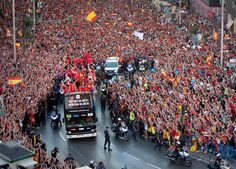 Spain's soccer team celebrates with the Euro 2012 trophy on a double-decker bus during a victory parade on Monday, July 2 in Madrid. Spain beat Italy 4-0 in the championship game.