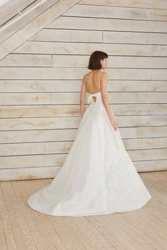 Taffeta a-line gown with twisted front and bow detail on the back