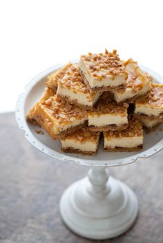 Caramel Toffee Cheesecake Bars | Annie's Eats ~T~ These have a graham cracker crust with toffee bits, a filling of cream cheese, sour cream and caramel sauce and are topped with caramel sauce and more toffee bits. Yum, Yum, Yum.