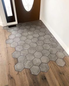 Entrywith a mix of flooring materials