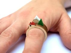 This laser cut wood ring is actually three separate rings together. Etsy artist Clive Roddy sells them in sets of three with a series of houses, trees, or mountains and it's up to you how you match them together.