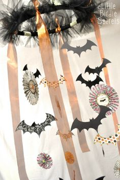 halloween chandelier- embroidery hoop (painted black), black tulle knotted around hoop, diff halloween ribbon and dies hanging on fishing line