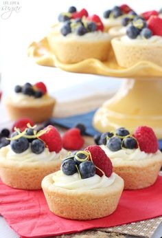 Berry Lemon Cheesecake Cookie Cups - a lemon cookie cup is filled with a light no bake lemon cheesecake and topped with fresh berries!