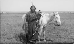 """A Comanche warrior named """"Ako"""" and his horse, photographed 1892."""
