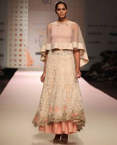 Beige high low work Lehenga featuring floral embroidery all over with an… Cape Designs, Lehenga Skirt, Designer Punjabi Suits, India Fashion Week, High Low Skirt, Beige Color, Colour, Elegant Outfit, Colorful Fashion