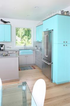 kitchen with bright turquoise cabinets (Benjamin Moore, Tropicana Cabana)