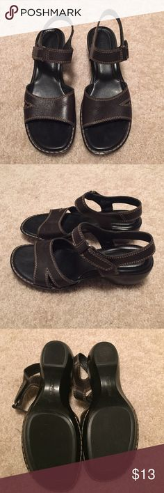 Naturalizer Black Sandle Brown leather open toe Sanford with Velcro strap around ankle. These are in excellent condition with very little wear on the bottom. The bottom inside of the strap on both shoes is wearing but is not visible when wearing. Naturalizer Shoes Sandals