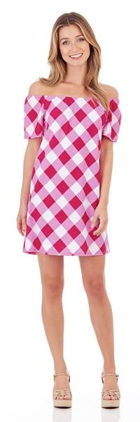 The Joy Dress is a versatile new style that can be work on or off the shoulder. Shop this flattering style in a cheerful bright pink gingham print.
