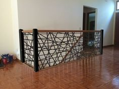 """Custom Steel Stair Railing is laser cut from 1/4"""" steel panel with 3"""" square tubing posts and powder coat painted with a textured matte black. Made in Rockford, IL By Aesthetic Metals, Inc."""