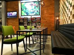 Green Pit chairs in a restaurant at Munich Ariport, Germany.    Hospitality, Interior, Design