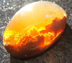 Opal Captures Fiery Sunset and Clouds Within