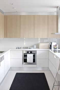 white and light wood textured modern kitchen